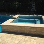 Pool Plaster, pool tile, coping, Stone Veneer, pavers, spa, baja Bench, and fire pit