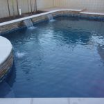 pool spa raised bond beam stack stone