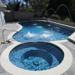 Pool spa white coping pavers handrail waterfeatures