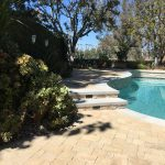 backyard with pool pavers coping radiant fusion pearl