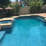 Pool Spa with tiled Dam wall and veneer on raised bond beam