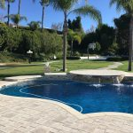 Pool with pavers and different raised bond beam heights