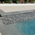 Pool and raised bond beam tiles coping