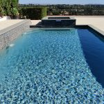 Pool with raised Spa raised bond beam and Pavers